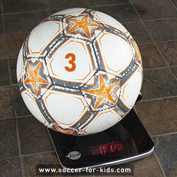 Size 3 soccer ball on kitchen scale