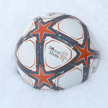 Soccer Ball in Winter Snow