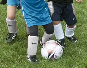 Young soccer player legs
